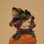 Witch on pumpkin